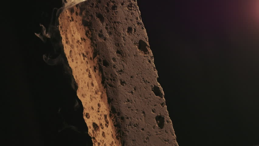 Artistic reproduction of a rock monolith with smoke and light
