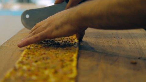 urkish and Arabic Traditional Ramadan Bread Sliced Etli Ekmek Konya (Pide or Lahmacun) prepared by cook