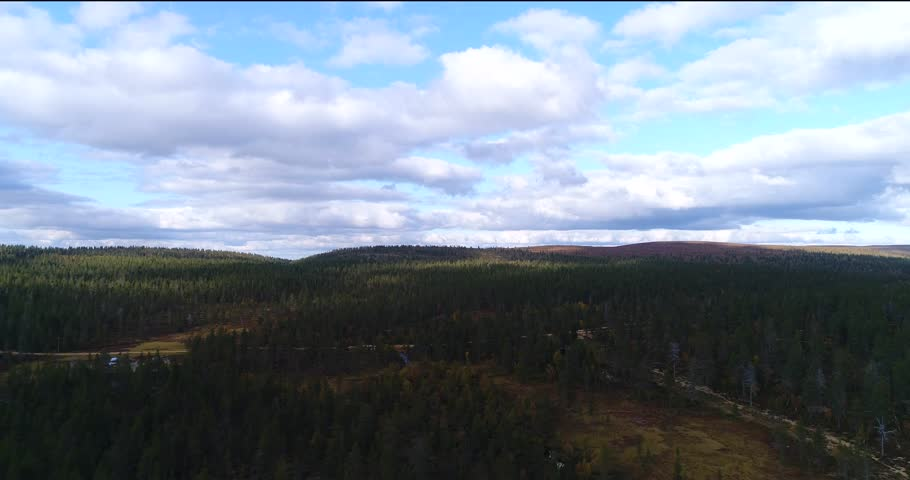 National forest, Cinema 4k aerial view over arctic forest and swamp, in urho kekkonen national park, near kiilopaa fjeld, saariselka, in Lapland, on a sunny autumn day, in Lappi, Finland. | Shutterstock HD Video #33035413