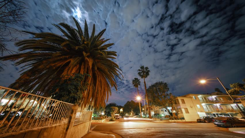 Moon shining through clouds at night in residential neighborhood of West Hollywood, Los Angeles, California. 4K UHD Timelapse. | Shutterstock HD Video #33035611