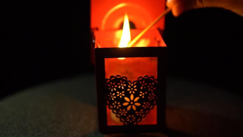 Close-up of a female hand holding a burning match and lighting a candle in & Close-up Of A Female Hand Holding A Burning Match And Lighting A ... azcodes.com