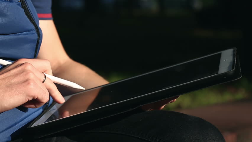 Closeup shot of designer's hand typing text On Tablet at park | Shutterstock HD Video #33082735