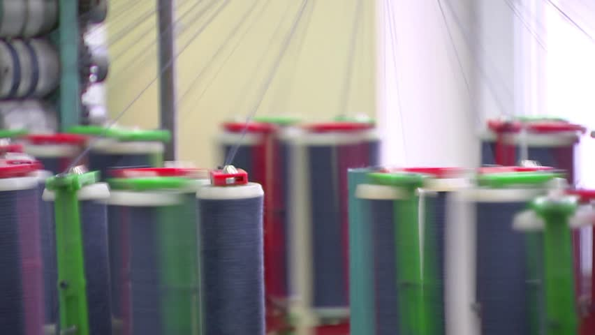 Garment manufacturing, with multi-colored coils coming off the thread | Shutterstock HD Video #33111544