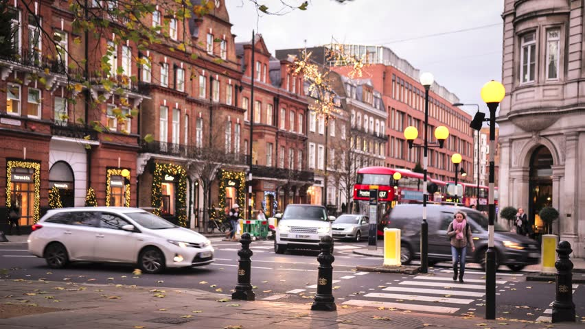 LONDON- NOVEMBER, 2017: Timelapse of Sloane Square and Sloane Street in Knightsbridge/Chelsea showing traffic and shoppers crossing the road