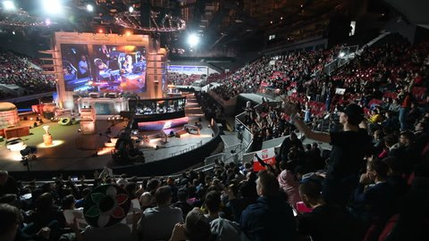 SAINT PETERSBURG, RUSSIA - OCTOBER 28 2017: EPICENTER Counter Strike: Global Offensive cyber sport event. Main stage and tribunes. Fan clapping hands and cheering for the team.