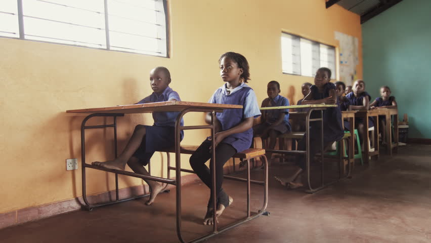 4k Front view of African pupils / students raising hand in class to answer teachers question. | Shutterstock HD Video #33160273