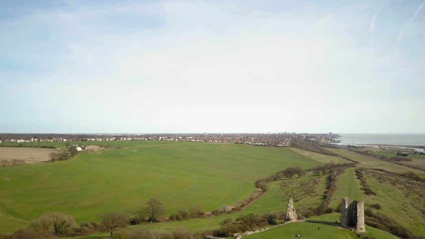 Hadleigh Castle, Essex, England. Aerial drone video footage dropping vertically from a view of the Thames Estuary to reveal the ruins of the landmark Hadleigh Castle, Essex.