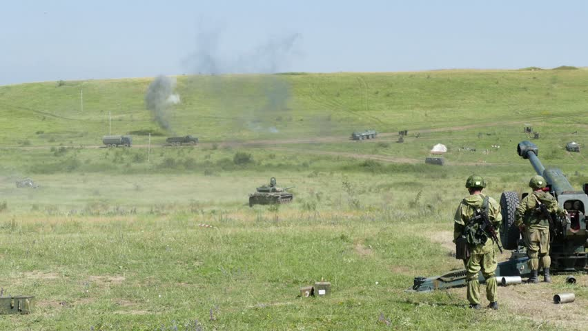 Under the cover of artillery, the tank advances to the battlefield and fires at targets
