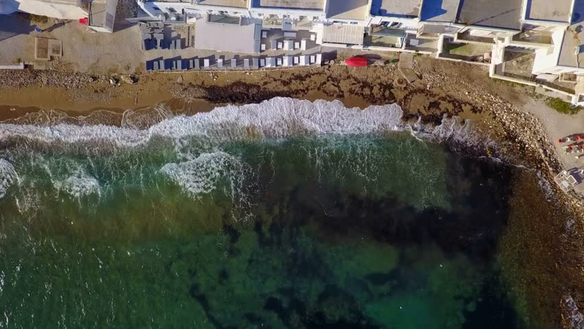 Spring 2017: Aerial bird's eye view video taken by drone of iconic and picturesque port of Naousa village, Paros island, Cyclades, Greece