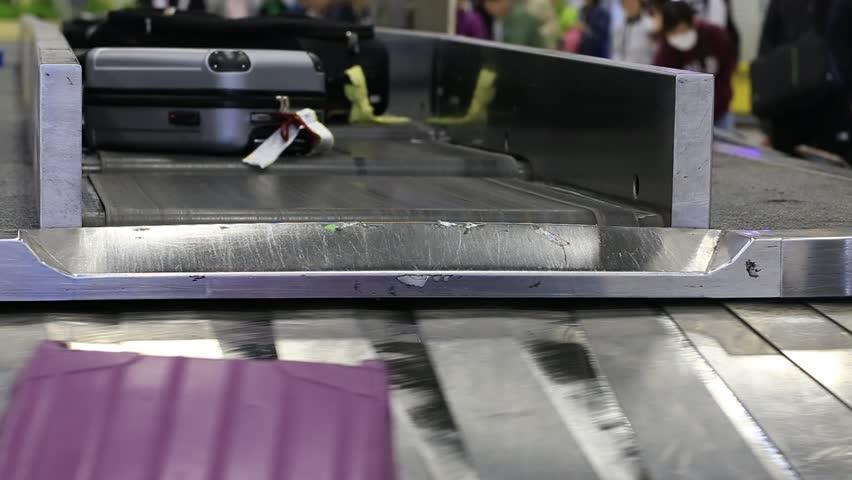 Baggage conveyor belt in the Suvarnabhumi Airport carrying the passenger luggage. Bangkok, Thailand