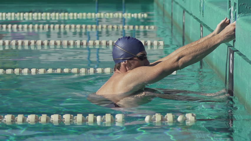Slow Motion Of Professional Male Swimmer Pushing Off In Streamline