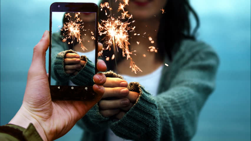 Handheld Cellphone and Girl with sparkler cinemagraph 4k