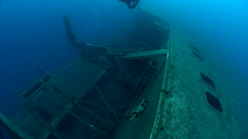 SCUBA divers exploring underwater wreck Zenobia | Shutterstock HD Video #33347983
