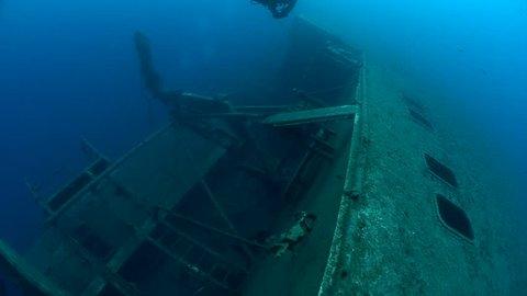 SCUBA divers exploring underwater wreck Zenobia