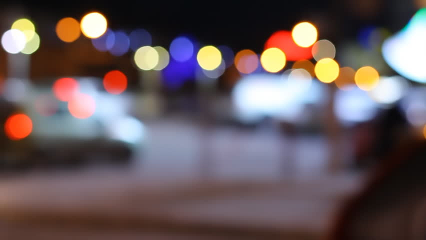 Lights of the night city. Blurred background. Silhouettes of cars and people. Nightlife. Multicolored bokeh. | Shutterstock HD Video #33355093