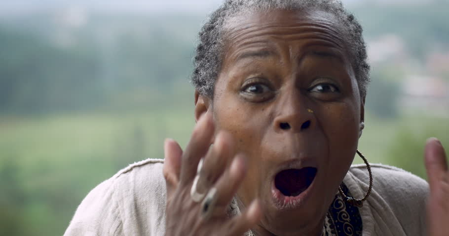 Happy surprised senior African American woman in 60s expressing she won something | Shutterstock HD Video #33364213