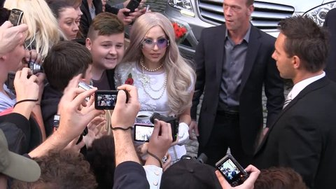 LONDON - NOV 11: Lady Gaga seen at her hotel with a cup of tea on Nov 11, 2011 in London.
