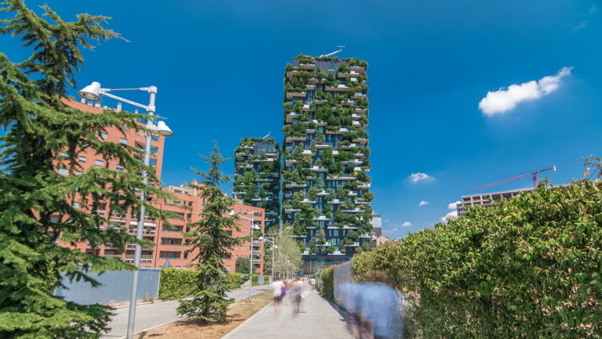 MILAN, ITALY - CIRCA JULY 2017: Bosco Verticale or Vertical Forest timelapse hyperlapse. It is a pair of two residential towers in the district of Porta Nuova, Milan. they host hundreds of trees and
