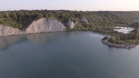 Flying closer towards the Scarborough bluffs and bluffs park peninsula from a high angle in a NE diagonal at a slow pace