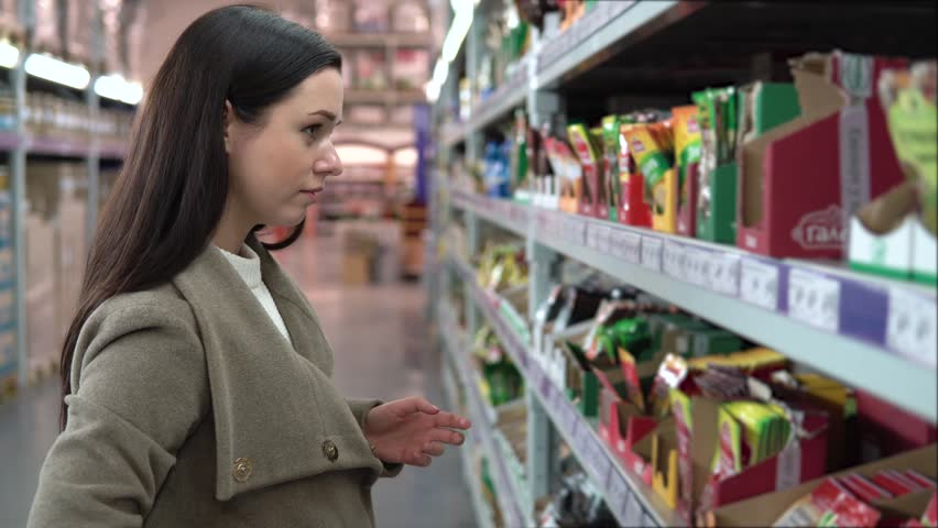 Young woman choosing spices in grocery store, beautiful woman shopping in a supermarket   Shutterstock HD Video #33505597