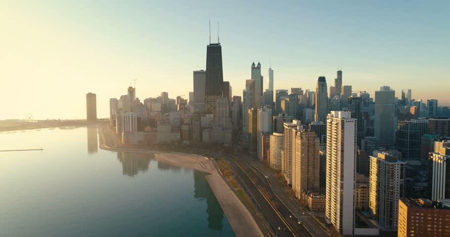 Aerial shot of Chicago Downtown skyline at sunrise. Buildings by the lake with road and cars | Shutterstock HD Video #33539863