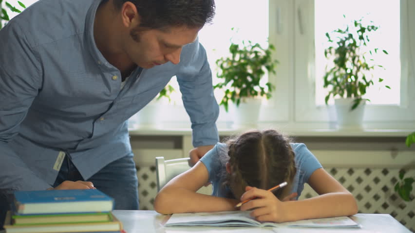 Dad is angry because his daughter don't want to do her homework. | Shutterstock HD Video #33555853