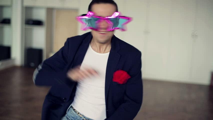 Man dancing funky, cool dance in ballroom, steadicam shot  | Shutterstock HD Video #3355733