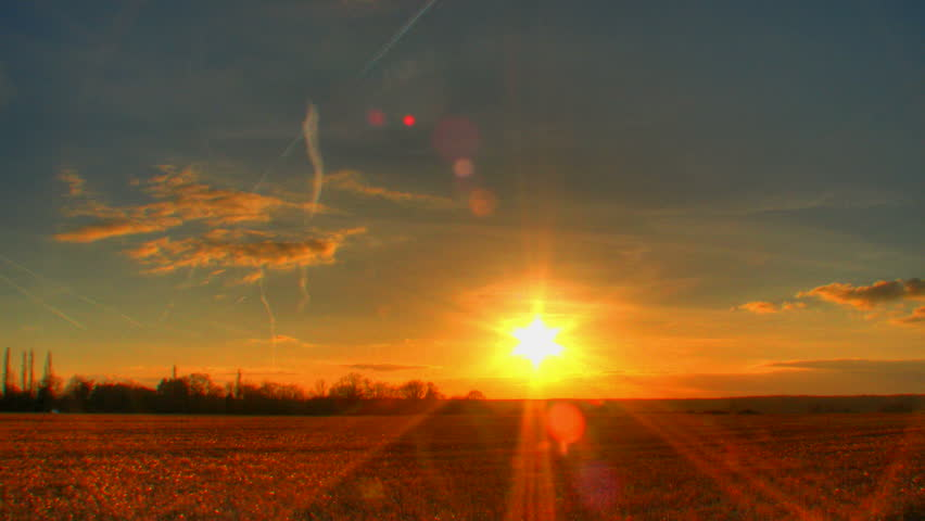 Sunset over corn fields, HD time lapse clip, high dynamic range imaging