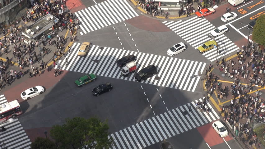Fast motion of Shibuya pedestrian crossing and car traffic by day, Tokyo, Japan
