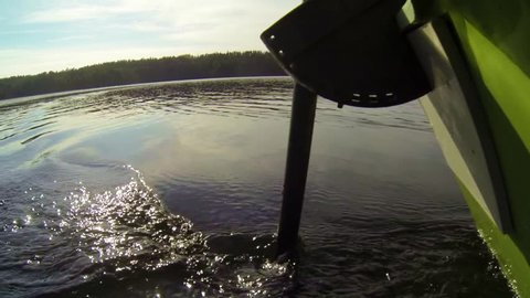 Electric outboard motor being used with a rowing boat.