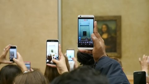 Paris, France - November 3, 2017:The well-known masterpiece painted by Leonardo da Vinci called Mona Lisa, belonging to the period of Italian Renaissance in Louvre.