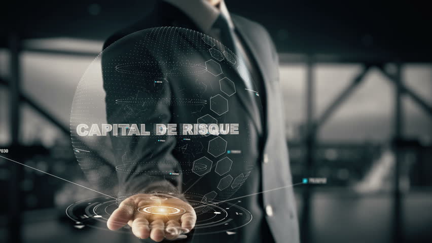 Capital de risque(French) with hologram businessman concept, in English Venture capital | Shutterstock HD Video #33631093