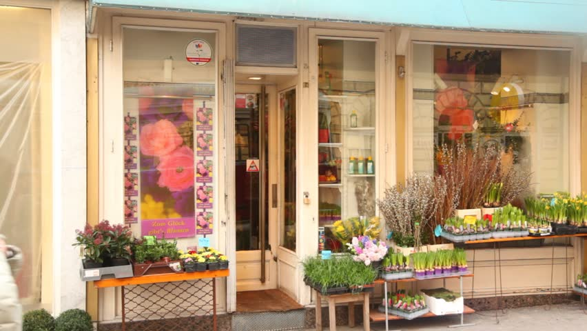 VIENNA- FEB 20: People pass by small flower shop on FEB 20, 2012 in Vienna, Austria. Vienna, the capital of Austria, is a paradise for all shopping addicts.