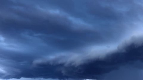 White clouds flying blue sky time lapse. Cumulus clouds fast flying sky timelapse. Abstract clouds flying, moving, running, rolling, morphing sky. Clouds flying, moving heavenly sky video footage