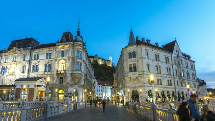 Ljubljana City Centre at night, hyperlapse timelapse video. Preseren Square,Triple Bridge and view of Castle at night from Bridge, Slovenia.