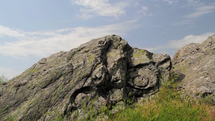 The sun light up mysterious ancient symbol carved on a rock in Thracian midlands, southeast Bulgaria.