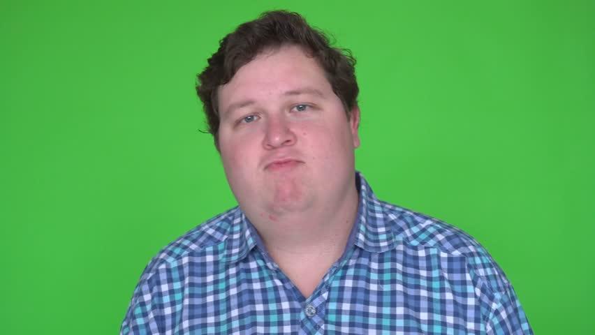 Fat young man dancing on a green screen. 4k