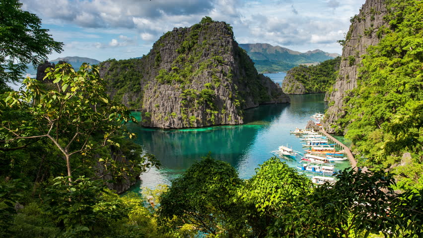 Coron, Philippines - December 16, 2017: Coron Timelapse view showing Kayangan lake viewpoint with outrigger tourist boats and natrual island surrounds