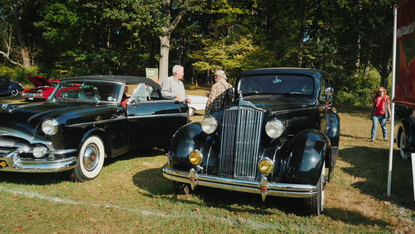 Rockville, MD, USA, October 2017: Free Open Air exhibition of retro cars. Visitors are admiring old cars