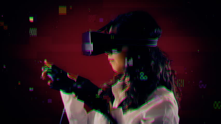 Digital glitch errors appearing on a girl wearing a virtual reality headset and wired gloves, making gestures in the air. Side shot.  | Shutterstock HD Video #33711733