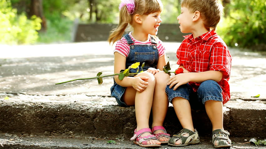 Two child speaking and boy present flower stock footage video two child speaking and boy present flower stock footage video 3372503 shutterstock altavistaventures Image collections