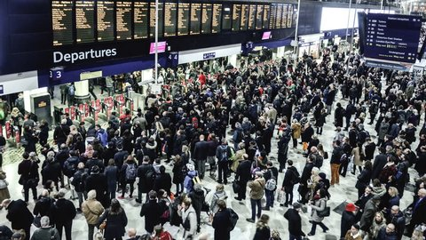 LONDON- DECEMBER, 2017: Timelapse of crowds of people gathering on concourse at London Waterloo Station at rush hour