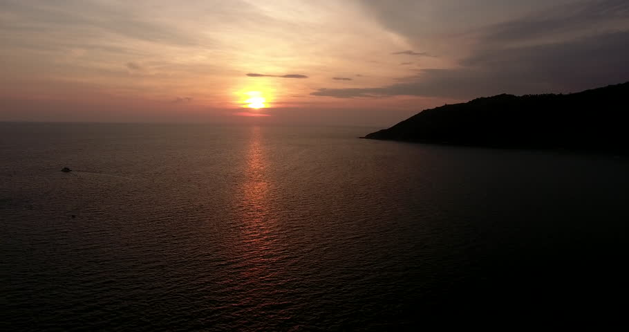 Panoramic view shooting from flying drone of endless calmness ocean with sunset on horizon.Bird's eye footage of sea surface and tropical island in Asia   Shutterstock HD Video #33760933