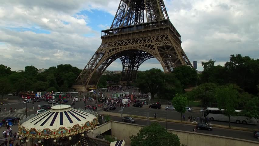 Fascinating aerial drone view on Eiffel Tower, national symbol Paris France Champ de Mars tall steel monument cloudy day