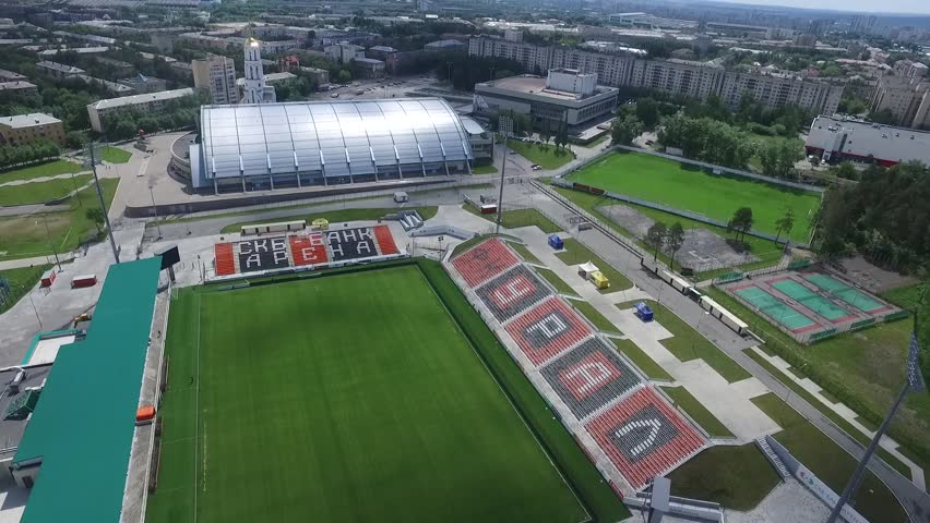 Ekaterinburg, Russia July 23, 2017: Aerial view of a modern stadium. Footage. Football field aerial view. Soccer stadium. Football stadium. FIFA World Cup 2018 training base | Shutterstock HD Video #33772843