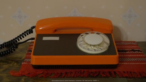 Old Soviet orange disk phone. Old phone in the Museum of history