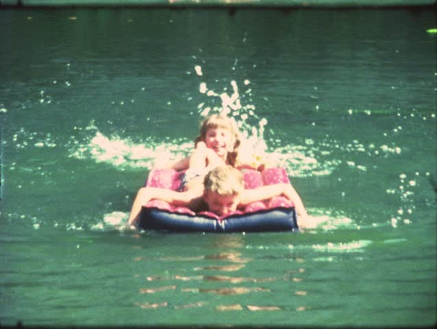 Vintage 8 mm film: Children swimming in lake
