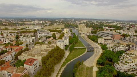 Descending aerial shot over the River Lez in Montpellier