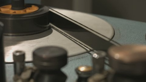 Film rolling in old film editing equipment start and stop