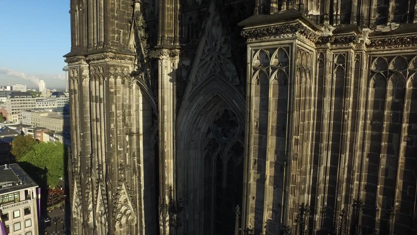 Aerial Drone moving to the top close detail shot at Cologne Cathedral in Germany 4k